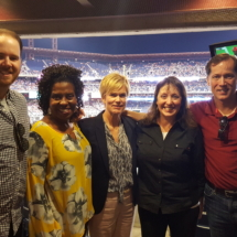 A great team of partners at a ballgame